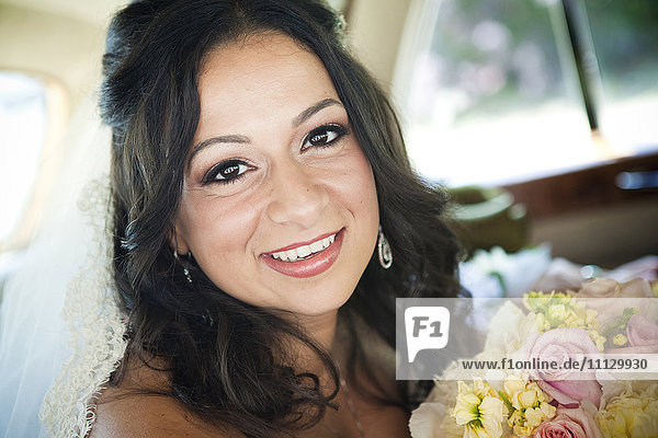 Egyptian bride holding bouquet