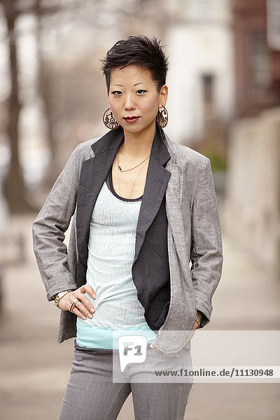 Korean woman standing with hands on hips