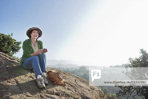 Caucasian woman hiking in remote area Caucasian woman hiking in remote area