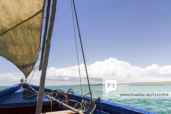 A traditional fishing boat in the emerald sea of Antsiranana