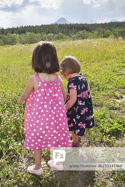 Girls walking together in field