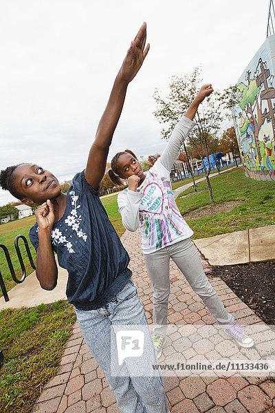 Black girls practicing cheer leading