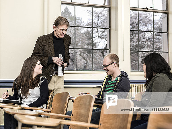 Teacher talking to students in classroom