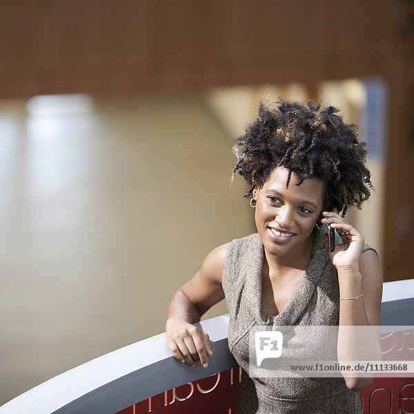 Mixed race businesswoman talking on cell phone