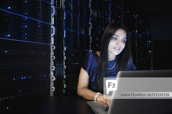 Indian businesswoman working in server room