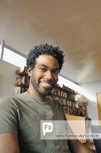 Black man smiling in living room