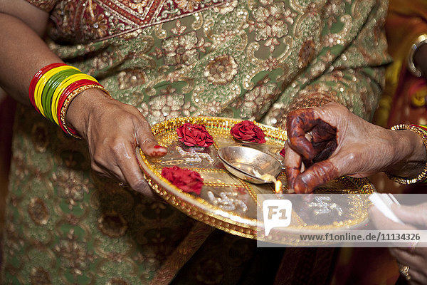 Indian woman holding tray and match