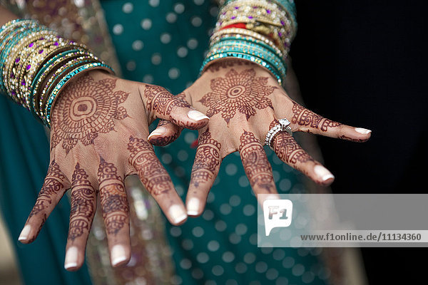 Close up of henna on Indian woman's hands