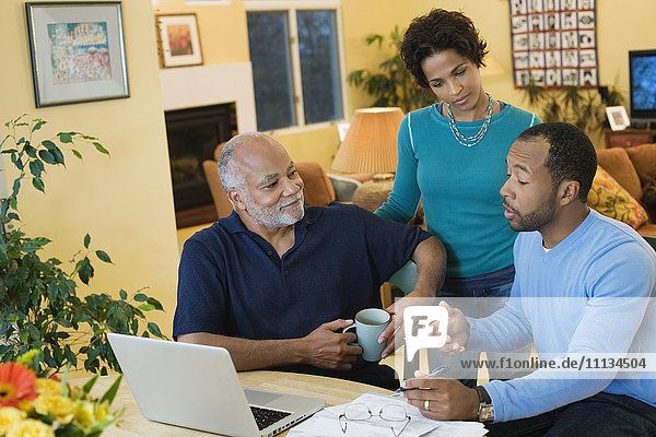 African American man with son and daughter talking