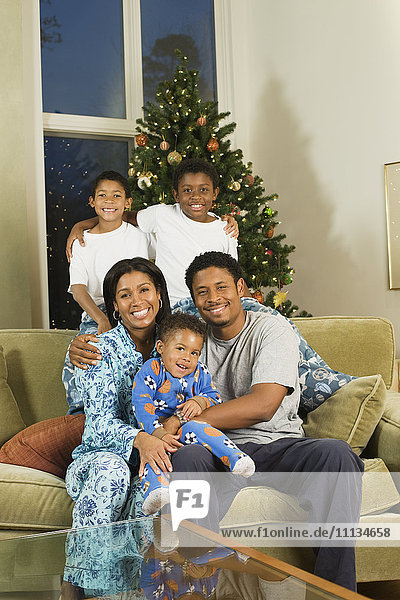 African American family in pajamas at Christmas time