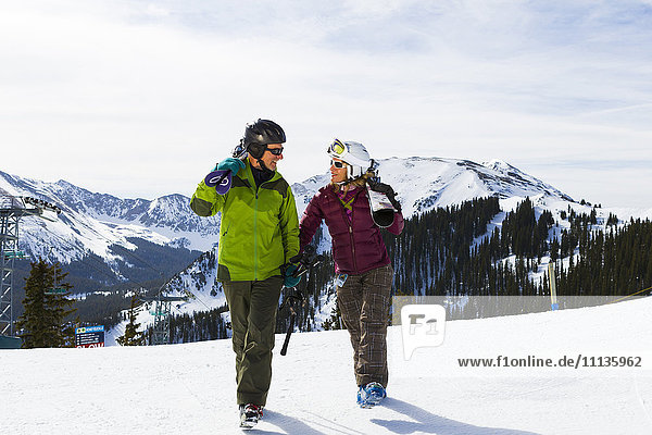 Caucasian couple skiing together