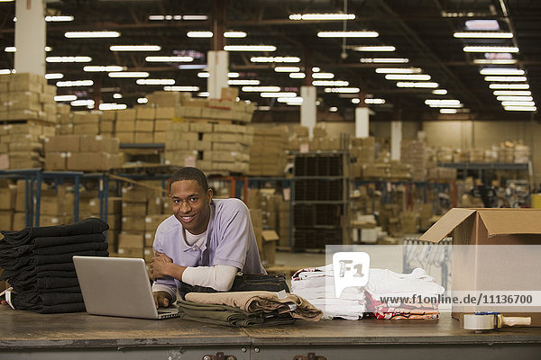 Black man working in warehouse