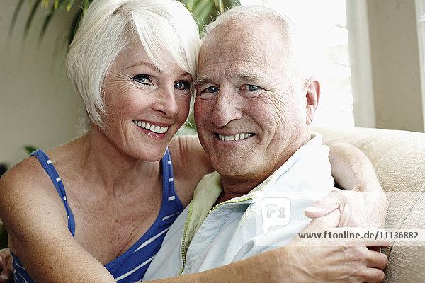 Caucasian couple hugging Caucasian couple hugging