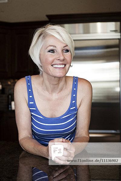 Caucasian woman in kitchen