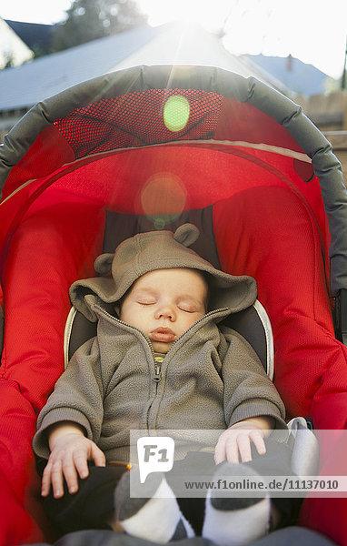 Caucasian baby sleeping in car seat Caucasian baby sleeping in car seat
