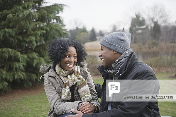 Couple sitting together in park