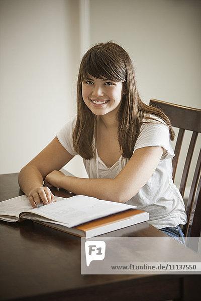 Mixed race woman doing homework