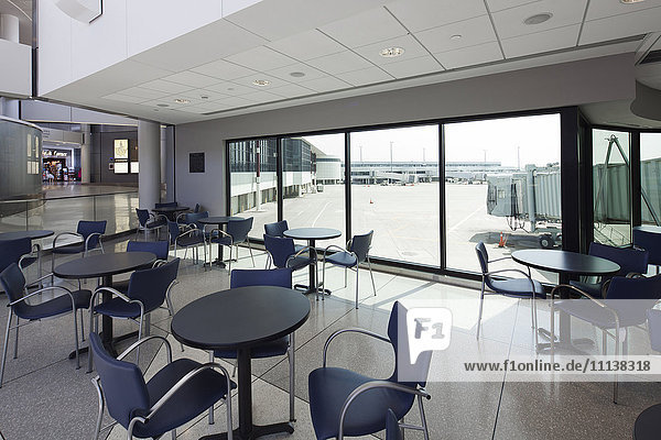 Empty cafe overlooking runway in airport