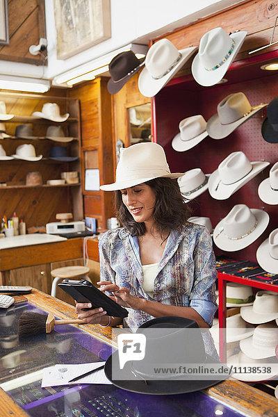 Ecuadorian woman working in hat store