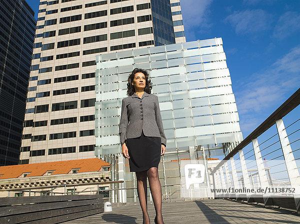 Caucasian Businesswoman standing in city