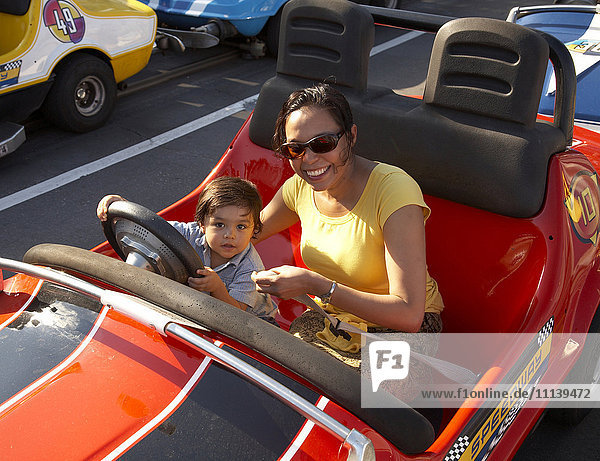 Mother and son in bumper car