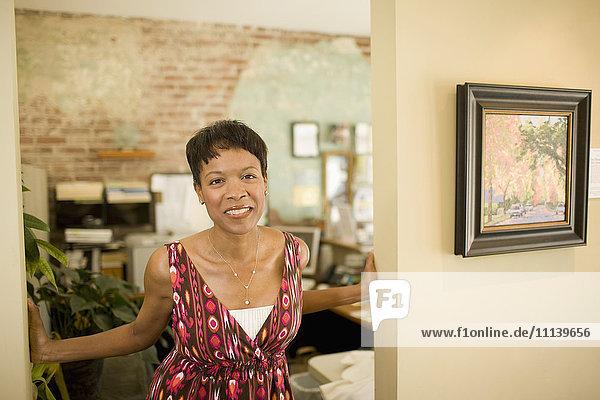 Mixed race woman standing in doorway