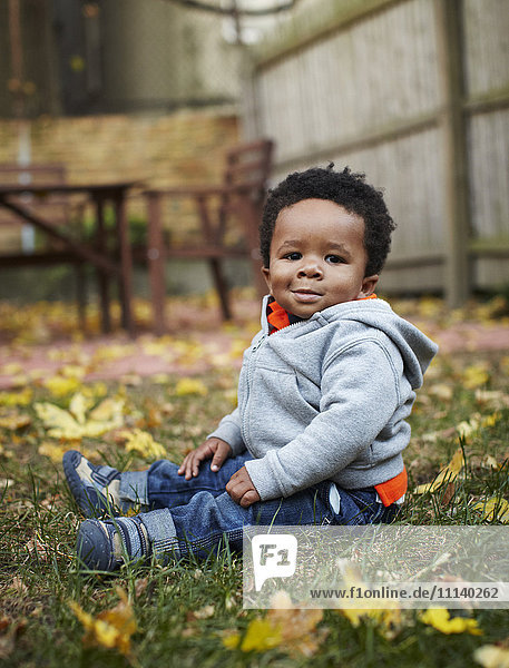African American baby sitting in grass