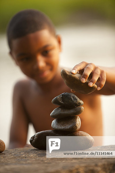 African American boy stacking rocks