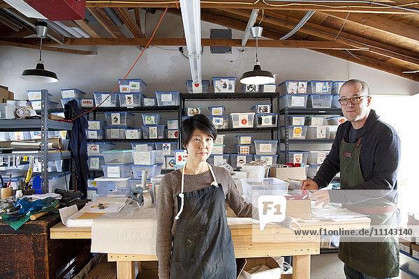 Entrepreneurs working in workshop