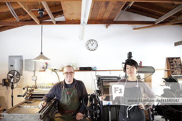 Entrepreneurs smiling in print shop
