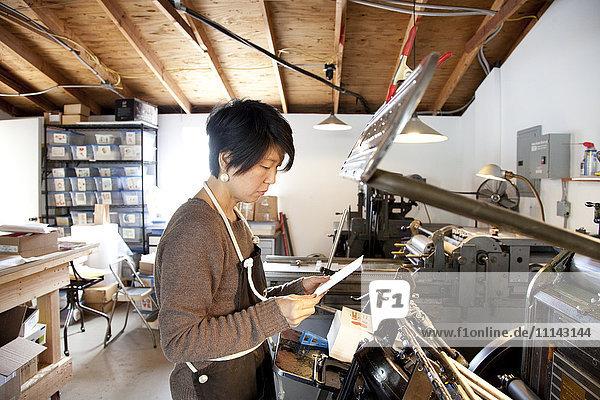 Japanese entrepreneur working in print shop