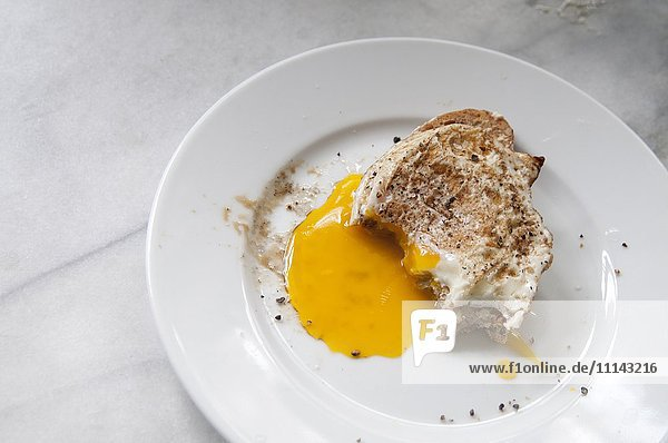 Close up of toast and runny egg yolk breakfast