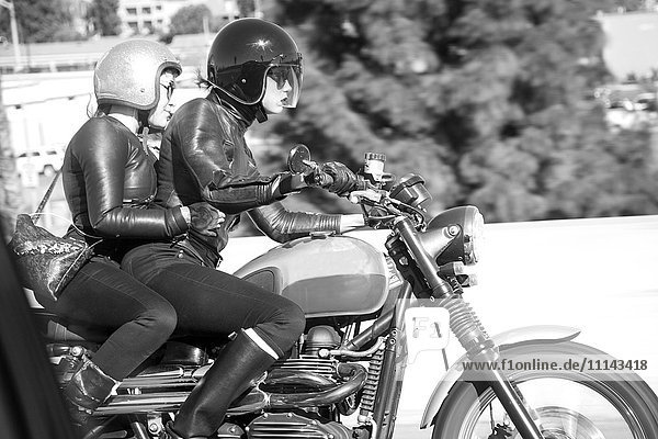 Blurred view of women riding motorcycle
