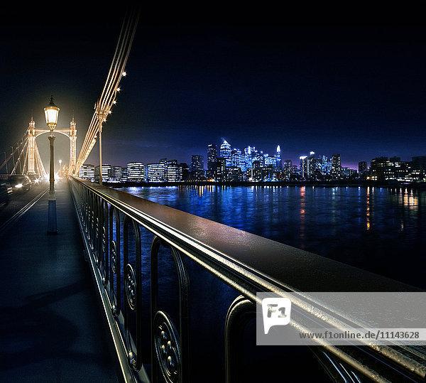 Railing on urban bridge at night  London  United Kingdom