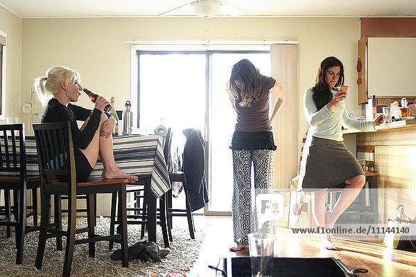 Women relaxing in dining room