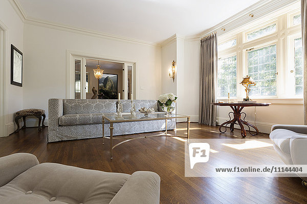 Sofa and armchairs in ornate living room