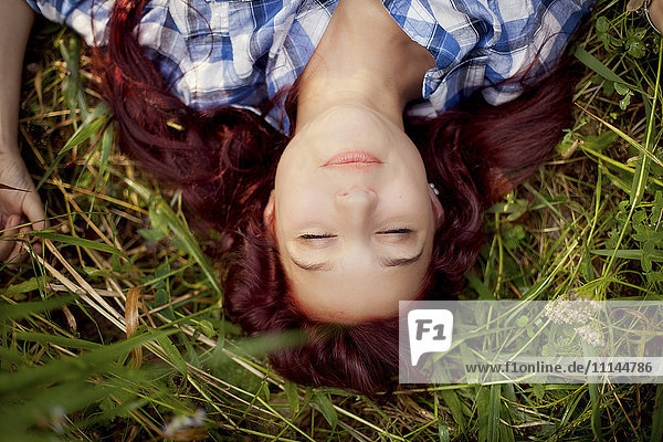 Close up of girl laying in grass