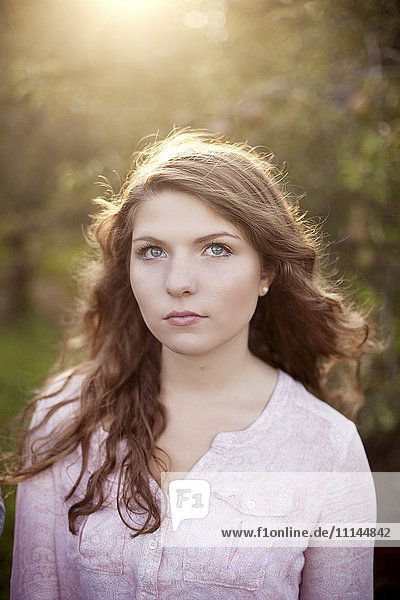 Close up of serious woman in field