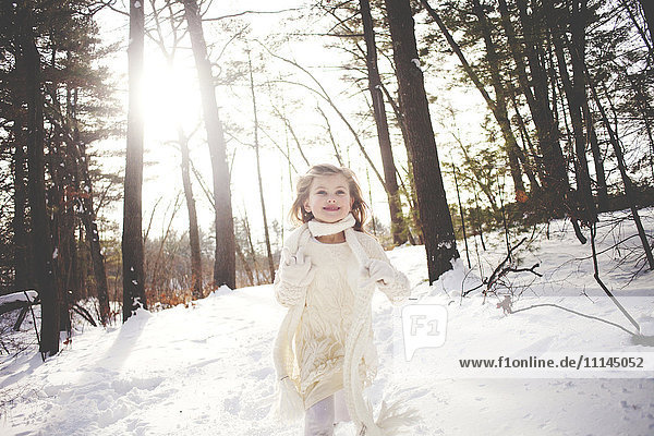 Caucasian girl running in snowy forest Caucasian girl running in snowy forest