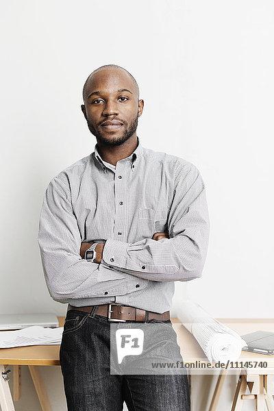 Portrait of confident Black architect in office