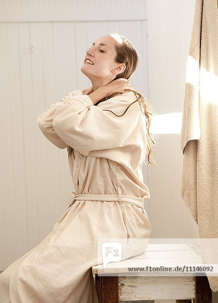 Caucasian woman wearing bathrobe in bathroom