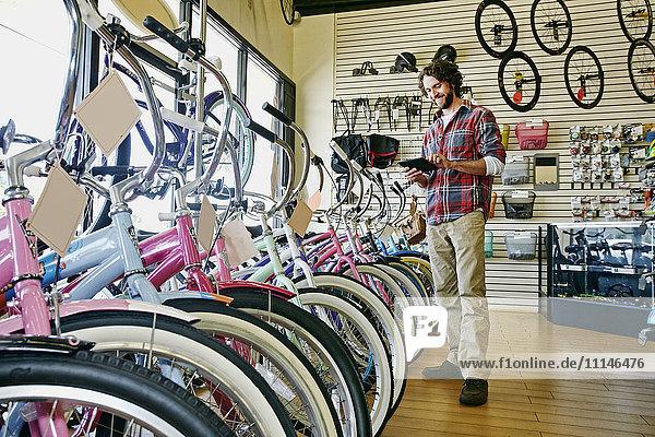 Caucasian man working in bicycle shop Caucasian man working in bicycle shop