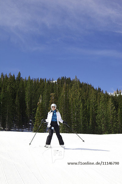 Woman skiing on snowy slope