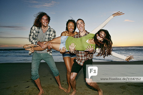 Friends posing together on beach