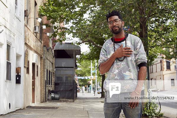 Black man standing on city street