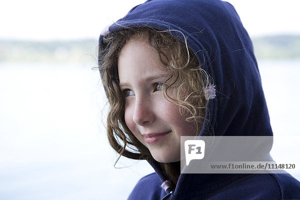 Caucasian girl wearing hood outdoors