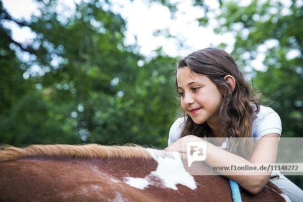 Close up of teenage girl riding horse