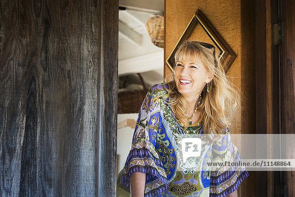 Caucasian woman smiling in doorway