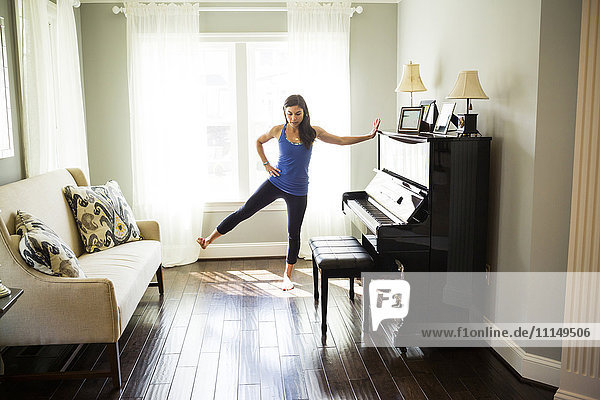 Woman stretching at window