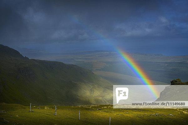 Rainbow over rural landscape